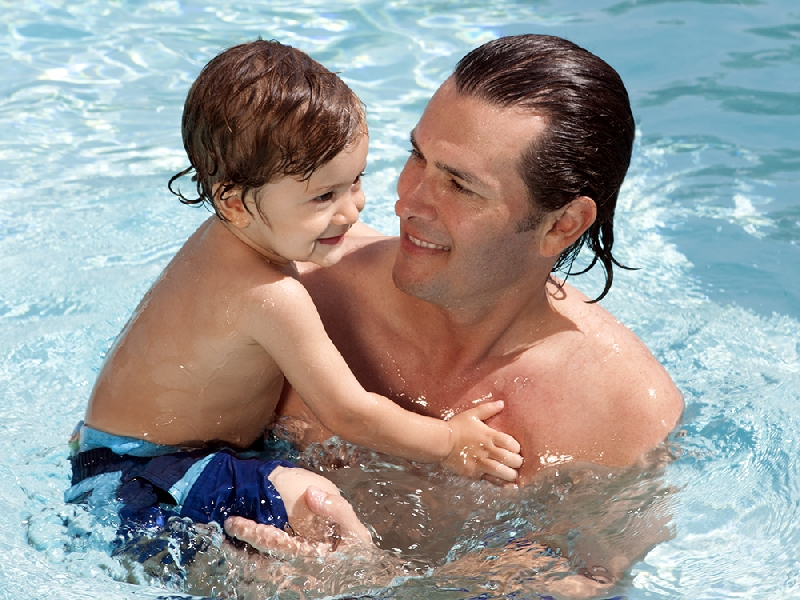 Dad and baby in the water