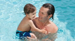 Dad and baby in pool